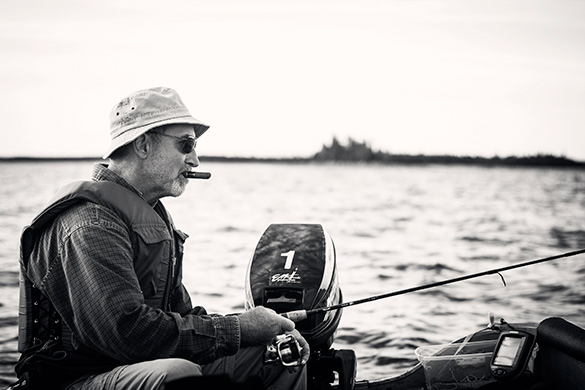 photograph of guy fishing